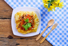 Plate of stuffed omelette with tablecloth Royalty Free Stock Image