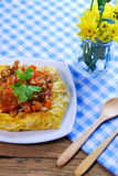Plate of stuffed omelette with tablecloth wooden spoon and fork Royalty Free Stock Images