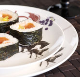 Plate of suchi. Plate of Japanese food served in the table Royalty Free Stock Photo