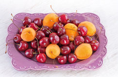 Plate of summer fruits Stock Images