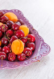 Plate of summer fruits Stock Photos