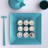 Plate with sushi, chopsticks and tea cup. View from above. Stock Image
