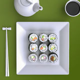 Plate with sushi, chopsticks and tea cup. View from above. Royalty Free Stock Photos