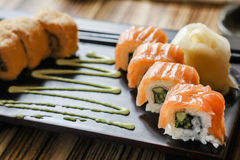 Plate sushi on restaurant table in lunch time. Plate sushi with sauce on restaurant table in lunch time Stock Images