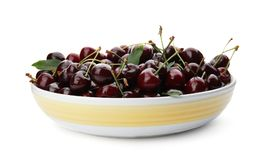 Plate with sweet red cherries. On white background Royalty Free Stock Images