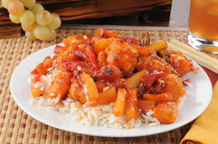 Plate of sweet and sour chicken. A closeup of a plate of sweet and sour chicken with chop sticks Royalty Free Stock Photography