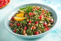 A plate of tabbouleh salad, close-up. Traditional Arabic food. stock photos