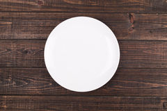 Plate on the table. A circle plate on the table Stock Images