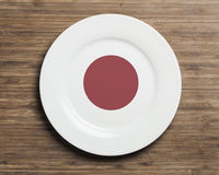 Plate on table with Japan flag Royalty Free Stock Images