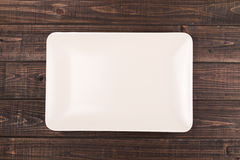 Plate on table. A square plate on the table Royalty Free Stock Photos