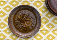 Plate on a table on tablecloth Stock Photography