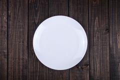 Plate on the table. A white plate on the table Stock Images