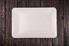 Plate on the table. A white plate on the table Royalty Free Stock Image