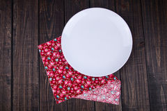 Plate on the table. A white plate on the table Stock Photo