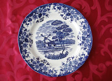 Plate on tablecloth. Blue plate on red tablecloth Stock Photo