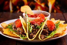 Plate with taco. Nachos chips and tomato dip Royalty Free Stock Images