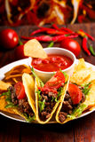 Plate with taco. Nachos chips and tomato dip royalty free stock photography