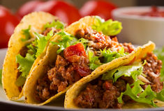 Plate with taco. And fresh tomatoes Stock Image