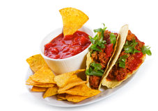 Plate with taco, tortilla chips and tomato dip Royalty Free Stock Photography