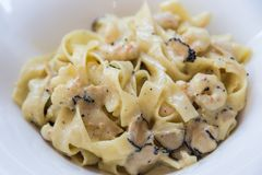 Black truffle pasta with shrimps Royalty Free Stock Photography