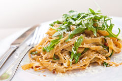 Plate of tagliatelle with sundried tomato and rock Royalty Free Stock Image