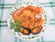 Plate of tagliolini with shellfish and tomato sauce Royalty Free Stock Photo