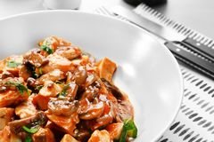 Plate with tasty chicken cacciatore Stock Images