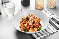 Plate with tasty chicken cacciatore. On table Royalty Free Stock Photography