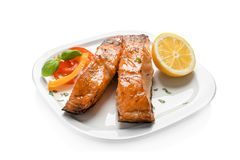 Plate with tasty cooked salmon. On white background Stock Photography