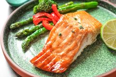 Plate with tasty freshly cooked salmon. Closeup Stock Image