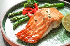 Plate with tasty freshly cooked salmon. Closeup Royalty Free Stock Image