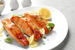 Plate with tasty freshly cooked salmon. Closeup Royalty Free Stock Photos