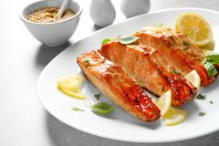 Plate with tasty freshly cooked salmon Royalty Free Stock Photo