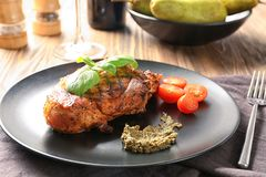 Plate with tasty grilled steak on table stock images