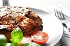 Plate with tasty grilled steak on table, closeup stock image