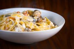 Plate of tasty Italian pasta Stock Image