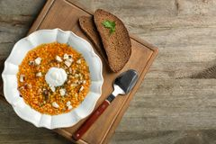 Plate with tasty lentil soup on  board Royalty Free Stock Photography