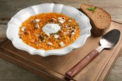 Plate with tasty lentil soup on  board. Plate with tasty lentil soup on wooden board Royalty Free Stock Photos