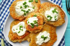 Plate with tasty potato pancakes for Hanukkah stock images