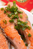 Plate with tasty salmon garnished Stock Photo