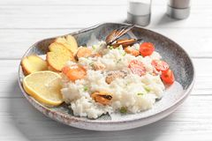 Plate with tasty seafood risotto. On table Stock Photo