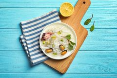 Plate with tasty seafood risotto. On wooden table Stock Photo