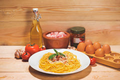 Plate of tasty spaghetti with tomato sauce and meat on wooden ta Royalty Free Stock Images