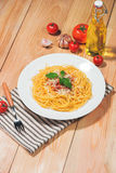 Plate of tasty spaghetti with tomato sauce and meat on wooden ta Stock Images