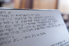 Plate with text for visually impaired people with spot focus effect Stock Photo