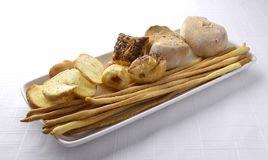 Plate with Toast Bread Breadstick. Plate with Assortment of Bread Crostini and Breadsticks Stock Photography