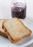 Plate of toast with jam Stock Photography