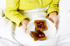 A plate of toast with jam Stock Photography