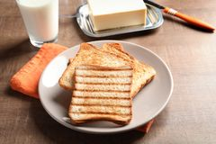 Plate with toasted bread. On table royalty free stock photos