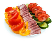 Plate of tomato, cucumber, ham and yellow pepper Stock Photo